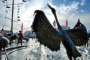 """One of the 12 stainless steel Brolga sculptures that make up the """"Dancing Brolga Fountain"""", by sculptor Terrance Plowright. Cockle Bay, Darling Harbour, Sydney."""