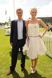 ROBERT SHEFFIELD and the HON.SOPHIA HESKETH at the Cartier International Polo at Guards Polo Club, Windsor Great Park, Berkshire on 25th July 2010.
