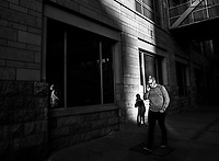 A man walks by on his cell phone, Minneapolis, Minnesota, USA.