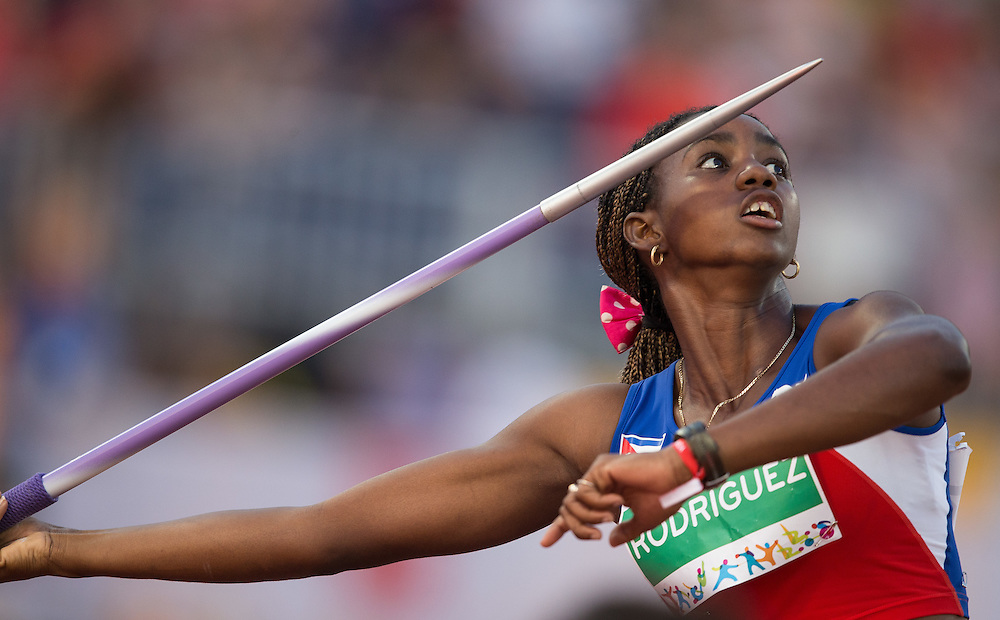 Yorgelis Rodriguez of Cuba throws the javelin during the women's heptathlon at the 2015 Pan American Games at CIBC Athletics Stadium in Toronto, Canada, July 25,  2015.  AFP PHOTO/GEOFF ROBINS