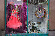 Garish costume on sale in a charity shop window, East Dulwich South London.