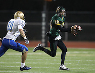 Kennedy's James Lizarraga (18) looses control of the ball as he is chased by Wahlert's Brady Williams (80) during the first half of the game between Cedar Rapids Kennedy and Dubuque Wahlert at Kingston Stadium in Cedar Rapids on Friday night, October 21, 2011.