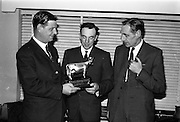 12/11/1964<br /> 11/12/1964<br /> 12 November 1964<br /> <br /> Mr. Eric Cragie Chairman presenting Mr P. Wogan with the Merville Perpetual Trophy while Mr. Victor Craigie Director and Sectrary looks on in admiration