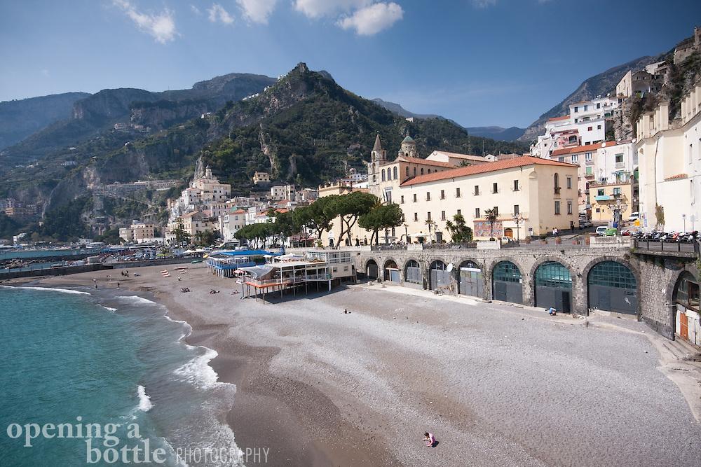 Beach scene with the city of Amalfi, Amalfi Coast, Campagna, Italy.
