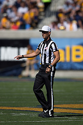 BERKELEY, CA - OCTOBER 03:  NCAA referee Chris Coyle stands on the field during the first quarter between the California Golden Bears and the Washington State Cougars at California Memorial Stadium on October 3, 2015 in Berkeley, California. The California Golden Bears defeated the Washington State Cougars 34-28. (Photo by Jason O. Watson/Getty Images) *** Local Caption *** Chris Coyle