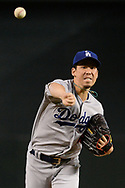 PHOENIX, AZ - AUGUST 31:  Kenta Maeda #18 of the Los Angeles Dodgers throws a warm up pitch for the MLB game against the Arizona Diamondbacks at Chase Field on August 31, 2017 in Phoenix, Arizona.  (Photo by Jennifer Stewart/Getty Images)