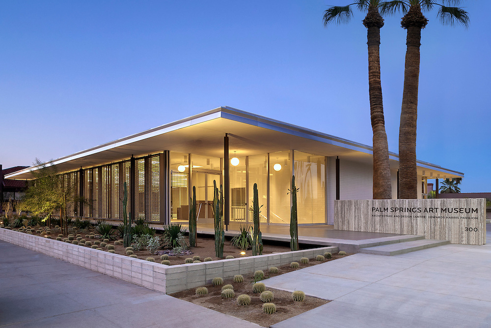 Exterior dusk photo of the new Architecture and Design Center in Palm Springs, CA. Center is a satellite building of the Palm Springs art museum. Building was designed in Mid 20th century by renowned architect E. Stewart Williams