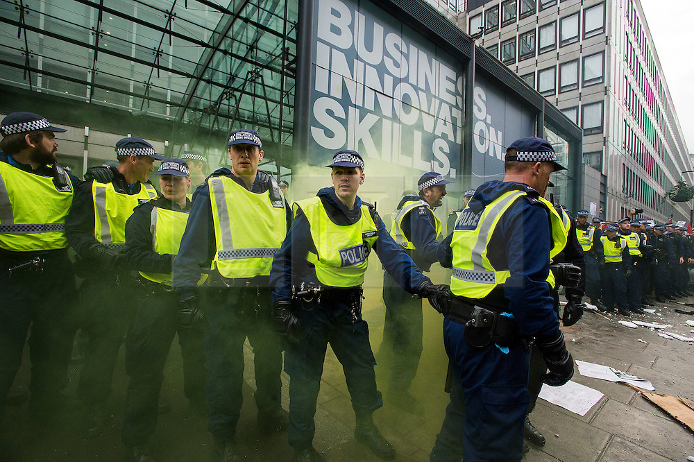 © Licensed to London News Pictures. 04/11/2015. London, UK.  Police guard the Department for Business, Innovations and Skills as Demonstrators clash with police as Thousands of students take part in a demonstration in central London against tuition fees. The rally which starts outside the University of London Union, will feature a speech from Shadow Chancellor John McDonnell.  Photo credit: Ben Cawthra/LNP