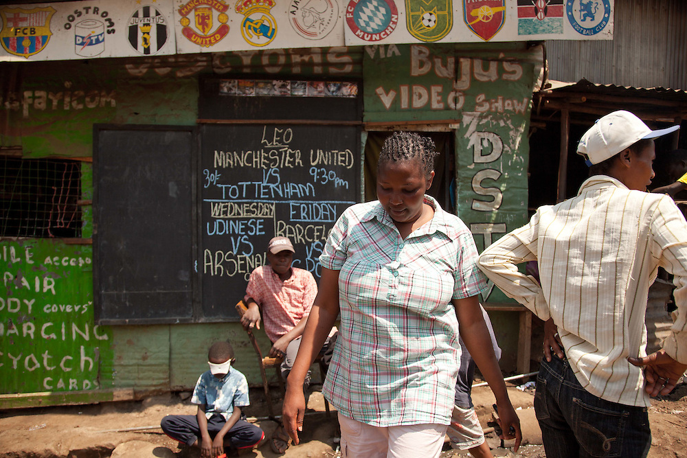 Beatrice walks along Biashara Street, one of the main business corridors in Mathare.