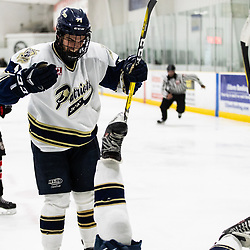 TORONTO, ON - APR 10, 2018: Ontario Junior Hockey League, South West Conference Championship Series. Game seven of the best of seven series between the Georgetown Raiders and the Toronto Patriots, Brett Bannister #11 of the Toronto Patriots celebrates a goal scored with Greame MacLean #16 of the Toronto Patriots during the second period.<br /> (Photo by Kevin Raposo / OJHL Images)