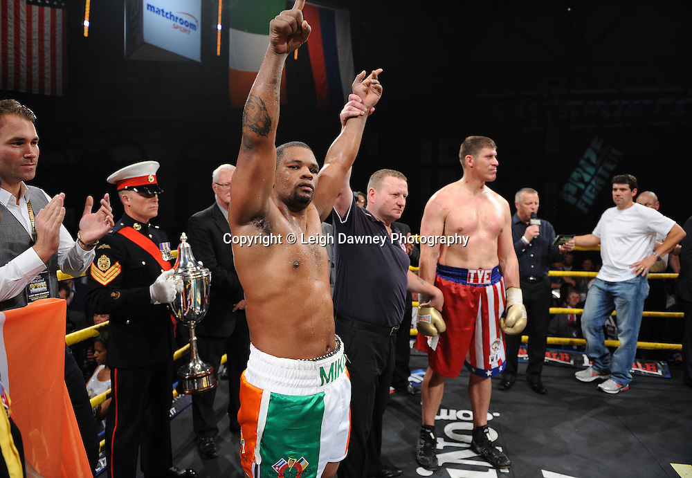 Mike Perez (Irish colour shorts) celebrates his win over Tye Fields to claim the title of Prizefighter International on Saturday 7th May 2011. Prizefighter / Matchroom. Photo credit © Leigh Dawney. Alexandra Palace, London.