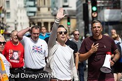 "Protesters march towards the BBC from Oxford Circus as several hundred protesters in London in central London demand the release of ""political prisoner"" right wing talisman Stephen Yaxley-Lennon  - also known as Tommy Robinson, who was imprisoned for contempt of court. London, August 03 2019."