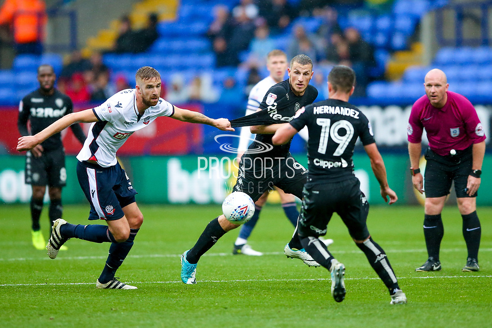Bolton Wanderers defender Mark Beevers (5) has a hold of Leeds United forward Chris Wood (9) shirt during the EFL Sky Bet Championship match between Bolton Wanderers and Leeds United at the Macron Stadium, Bolton, England on 6 August 2017. Photo by Simon Davies.