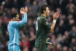 MANCHESTER, ENGLAND - Sunday, January 8, 2012: Manchester City's Joleon Lescott and goalkeeper Costel Pantilimon after the 3-2 defat by Manchester United during the FA Cup 3rd Round match at the City of Manchester Stadium. (Pic by Vegard Grott/Propaganda)
