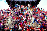 People gather on the Nyatapola Pagoda temple in Bhaktapur -- the third largest city in the Kathmandu Valley  --  from there to watch a grand procession celebrating the Nepali Hindu holiday of Gai Jatra