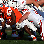 KurtSteiss2017<br /> <br /> Bowling Green's Andrew Clair (32) carries the ball amid a swarm of South Dakota defenders during the first half of a college football game between Bowling Green and South Dakota at Doyt Perry Stadium in Bowling Green, Ohio, on Saturday, September 9, 2017. THE BLADE/KURT STEISS