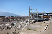 Scaffolding and excavation site at the House of the Dolphins, a luxurious dwelling in the Regio V suburb of Pompeii, which has revealed many frescoes including several of dolphins, in the Parco Archeologico di Pompei, or Archaeological Park of Pompeii, Campania, Italy. A new phase of official excavations has been taking place here since 2017 in an attempt to stop looters from digging tunnels and removing artefacts for sale. Pompeii was a Roman city which was buried in ash after the eruption of Vesuvius in 79 AD. The site is listed as a UNESCO World Heritage Site. Picture by Manuel Cohen