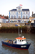 Fishing boat in harbour with Pier hotel, Harwich, Essex