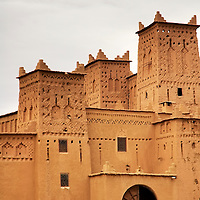 Man waiting  an old kasbah at morocco