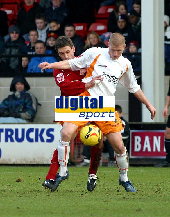Photo: Dave Linney.<br />Walsall v Blackpool. Coca Cola League 1. 31/12/2005.<br />Simon Osborn(Walsall) keeps a close check on  Keith Southern(Blackpool)
