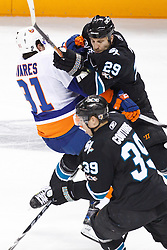 November 11, 2010; San Jose, CA, USA;  San Jose Sharks right wing Ryane Clowe (29) checks New York Islanders center John Tavares (91) during the second period at HP Pavilion. Mandatory Credit: Jason O. Watson / US PRESSWIRE