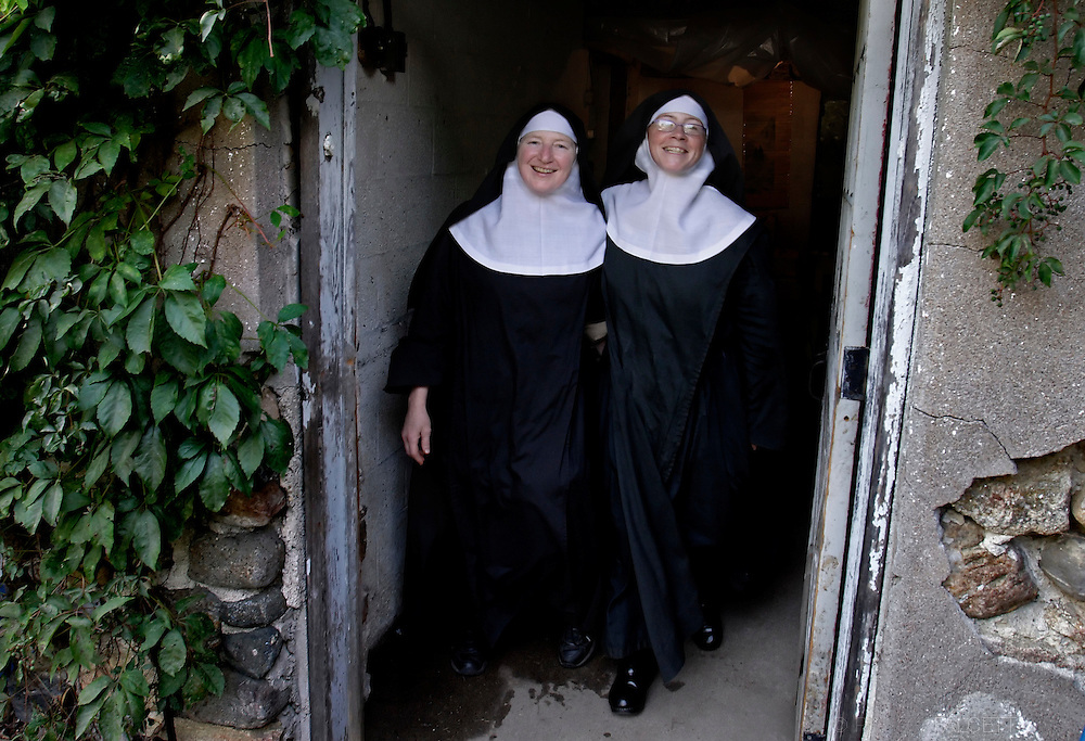 BETHLEHEM, CT- 11 OCTOBER 2005- 101105BF09-- Abbey of Regina Laudis nuns Mother Jadwiga Makarewicz (left) and Sister Ozanne Schumann walk out of a building on the abbey's property in Bethlehem. The abbey nuns follow the rule of St. Benedict and was the first female Benedictine abbey in the United States.   .Photo by Robert Falcetti