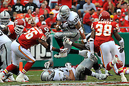 Running back Justin Fargas (25) of the Oakland Raiders hurdles over teammate offensive tackle Mario Henderson (75) and defenders Derrick Johnson (56) and DaJuan Morgan (38) of the Kansas City Chiefs in the second quarter at Arrowhead Stadium in Kansas City, Missouri on September 14, 2008.....