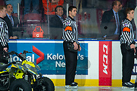 KELOWNA, CANADA - DECEMBER 7:  Referee Mike Langin stands at the boards during the national anthem a the Kelowna Rockets against the Victoria Royals on December 7, 2018 at Prospera Place in Kelowna, British Columbia, Canada.  (Photo by Marissa Baecker/Shoot the Breeze)