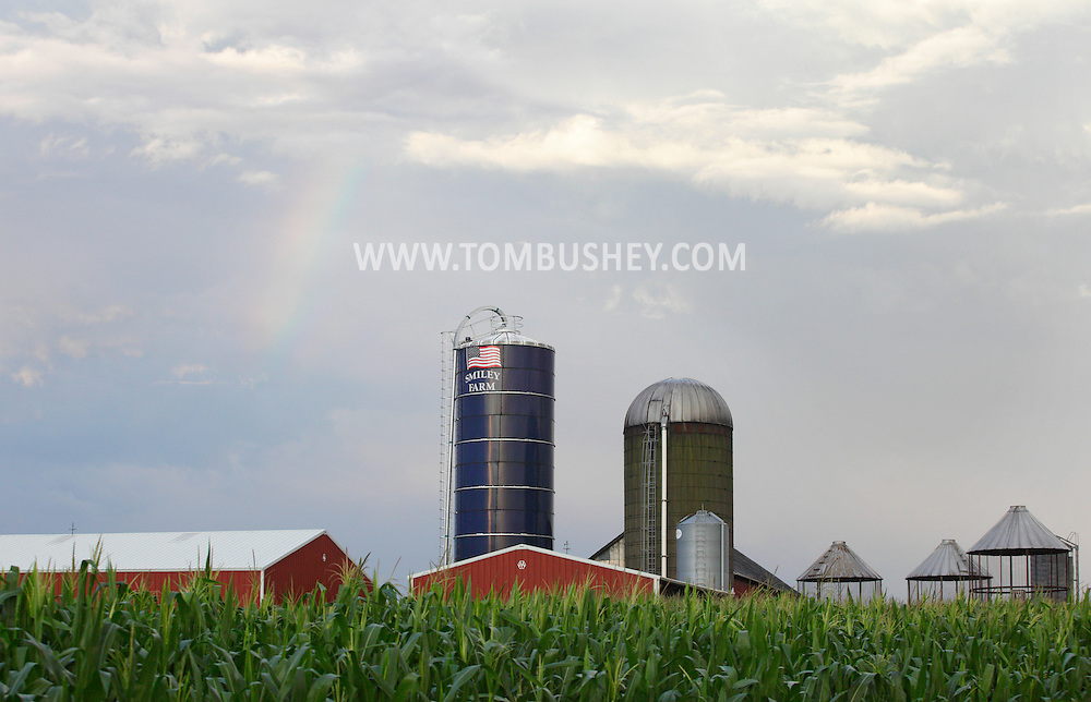 Middletown, New York -  A fading rainbow is visible in the sky behind the Smiley farm in the Town of Wallkill after a thunderstorm on July 21, 2010.