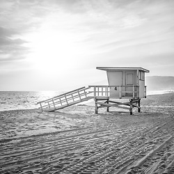 Malibu Zuma Beach lifeguard tower #4 sunset black and white photo. Malibu is a coastal beach city in Southern California in the United States or America. Copyright ⓒ 2015 Paul Velgos with All Rights Reserved.