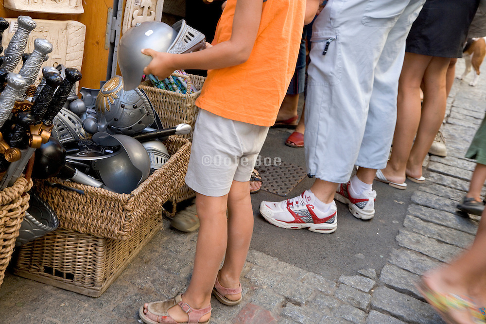 boy looking for toy souvenir at a tourist site France Carcassonne