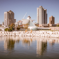 Milwaukee skyline picture with University Club Tower, Northwestern Mutual Tower, and Milwaukee Art Museum. Photo is high resolution and has subdued rustic vintage tone.