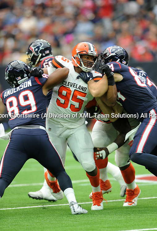 HOUSTON, TX - OCTOBER 15: Cleveland Browns DE Myles Garrett (95) fights off blockers during the NFL game between the Houston Texans and the Cleveland Browns on October 15, 2017 at NRG Stadium in Houston, TX. (Photo by John Rivera/Icon Sportswire)