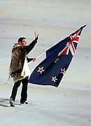 New Zealand's flag bearer Shane Dobbin  enters the stadium during the Sochi 2014 Winter Olympics Opening Ceremony in the Fisht Olympic Stadium on February 7, 2014 in Sochi, Russia. Photo: Ian MacNicol/www.photosport.co.nz