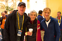2014 Boston Marathon: Joan Samuelson with friends in hotel lobby early morning before going to starting line for the race