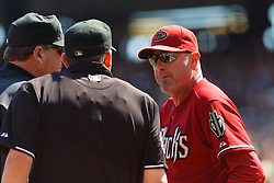 September 4, 2011; San Francisco, CA, USA;  Arizona Diamondbacks manager Kirk Gibson (right) argues with MLB umpire Brian Knight (center) and umpire Hunter Wendelstedt (left) after right fielder Justin Upton (not pictured) was ejected from the game during the fourth inning against the San Francisco Giants at AT&T Park. Arizona defeated San Francisco 4-1.