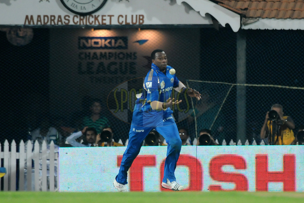 Kieron Pollard of Mumbai Indians finishes a catch during the Final of the NOKIA Champions League T20 ( CLT20 ) between The Royal Challengers Bangalore and The Mumbai Indians held at the M. A. Chidambaram Stadium in Chennai , Tamil Nadu, India on the 9th October 2011..Photo by Pal Pillai/BCCI/SPORTZPICS