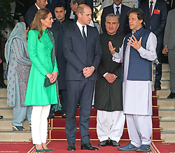 The Duke and Duchess of Cambridge with the Prime Minister of Pakistan Imran Khan (right) at his official residence in Islamabad during the second day of the royal visit.