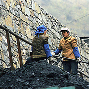 China is one of the largest producer of coal in the world. Some areas where coal is abundant the whole population works around the coal from extracting, refining, selling and also employing it for cooking and heating. Many women are working in coal mining, although they are not allowed to work underground. . .