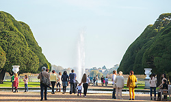 © Licensed to London News Pictures. 31/10/2014. Hampton, UK People enjoy the warm weather at Hampton Court Palace today 31st October 2014. forecasters are predicting It could be the warmest halloween on record. Photo credit : Stephen Simpson/LNP