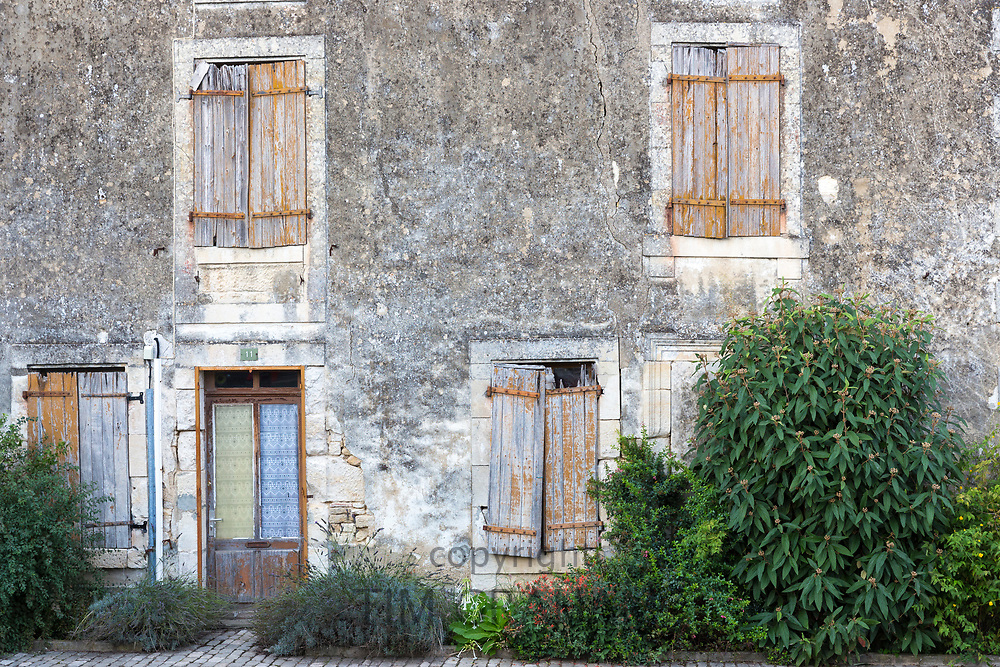Ancient architecture and window shutters in Coulon in the Marais Poitrevin region a Grand Site de France