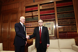 Newly appointed Greek Prime Minister Lucas Papademos (R) shakes hands with outgoing Prime minister George Papandreou at the Maximos mansion in Athens November 11, 2011. Technocrat Papademos took office Friday to save Greece from bankruptcy, heading a coalition cabinet filled with many of the same politicians who led the nation into crisis. . Photo by Imago/i-IMAGES