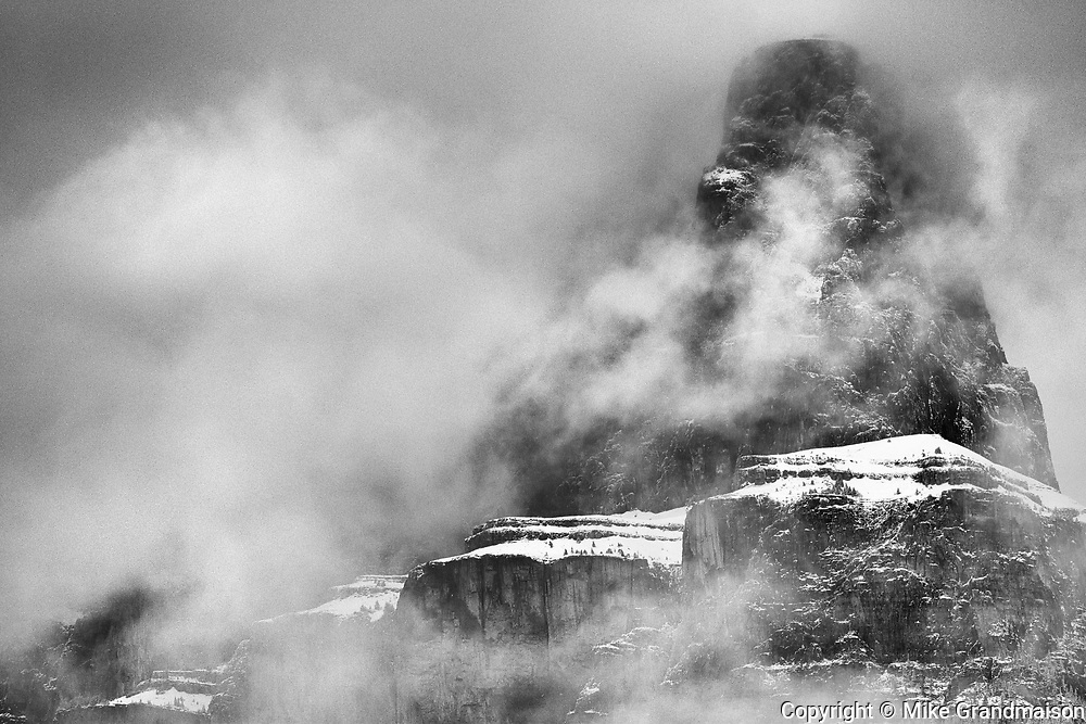 Castle Mountain peak in fog. Icefields Parkway.<br />Banff National Park<br />Alberta<br />Canada