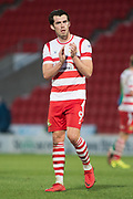 Doncaster Rovers Forward John Marquis (9) claps to the Doncaster fans during the The FA Cup match between Doncaster Rovers and Scunthorpe United at the Keepmoat Stadium, Doncaster, England on 3 December 2017. Photo by Craig Zadoroznyj.