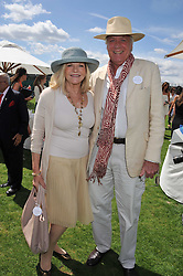 JO MILLER and JOHN RENDALL at the 27th annual Cartier International Polo Day featuring the 100th Coronation Cup between England and Brazil held at Guards Polo Club, Windsor Great Park, Berkshire on 24th July 2011.