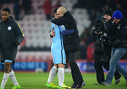 Manchester City manager Josep Guardiola embraces Sergio Aguero of Manchester City at full time.  - Mandatory by-line: Alex James/JMP - 13/02/2017 - FOOTBALL - Vitality Stadium - Bournemouth, England - Bournemouth v Manchester City - Premier League