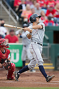 Mitch Canham (6) of the Northwest Arkansas Naturals follows through his swing after making contact on a pitch during a game against the Springfield Cardinals at Hammons Field on July 28, 2013 in Springfield, Missouri. (David Welker)