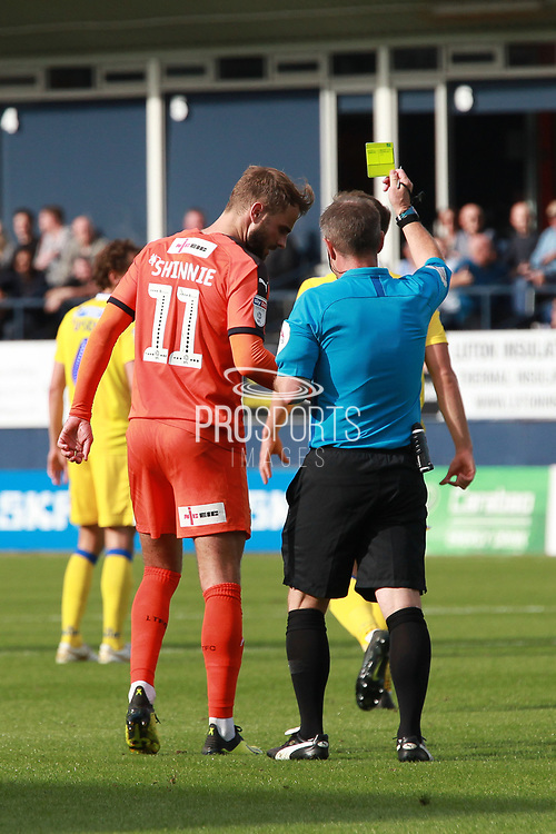 Luton Town midfielder Andrew Shinnie (11) is shown a yellow card, booked during the EFL Sky Bet League 1 match between Luton Town and Bristol Rovers at Kenilworth Road, Luton, England on 15 September 2018.