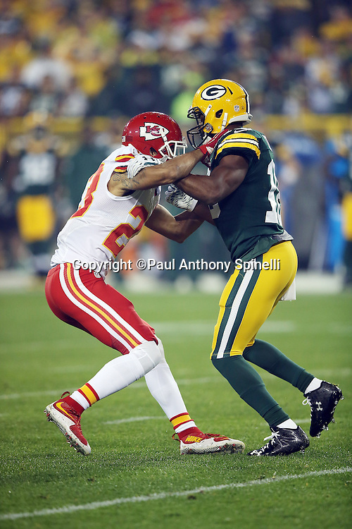 Kansas City Chiefs cornerback Phillip Gaines (23) bumps Green Bay Packers wide receiver Randall Cobb (18) on a pass route during the 2015 NFL week 3 regular season football game against the Green Bay Packers on Monday, Sept. 28, 2015 in Green Bay, Wis. The Packers won the game 38-28. (©Paul Anthony Spinelli)