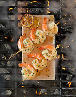 Grilling shrimp skewers on a salt block by St. Louis Food Photographer Jonathan Gayman for The Insatiable Lens